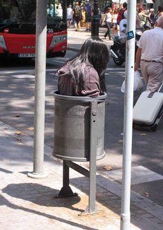 street art by Mark Jenkins in Barcelona, Spain http://restreet.altervista.org/mark-jenkins-critica-la-nostra-abitudine-allindifferenza/