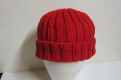 A simple ribbed knit beanie, knitted flat for teaching purposes, and sewn up. Could have done with a pompom really.