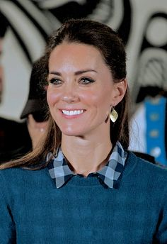 """""""Catherine, Duchess of Cambridge, smiles as she attends an official welcome performance during her visit to First Nations Community Members in Edlers Lodge on September 25, 2016."""""""