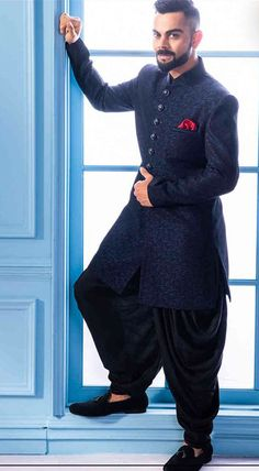 Buy Solemn Blue Indo Western - Contemporary wear from the house of Manyavar. Choose from a wide range of designer Indo western, Sherwani, traditional dresses for men online. Mens Indian Wear, Indian Groom Wear, Indian Men Fashion, Mens Fashion Suits, Mens Ethnic Wear, Mens Wedding Wear Indian, Mens Suits, India Fashion Men, Groom Fashion