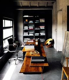 Black is the new vibe. Love when it's mixed with textures like blond wood and concrete - great masculine & modern vibe - 70 Gorgeous Home Office Design Inspirations | DigsDigs
