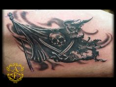 Ripped Pirate Flag Tattoo done by Sean Ambrose at Arrows and Embers Custom Tattooing