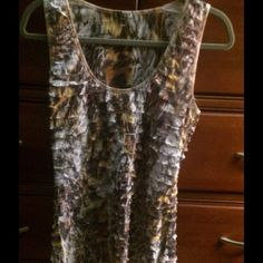 Pretty Cache layered ruffed tank.  Stretchy! Super pretty multi-layered tank.  Long length covering hips.  Brown, gold and white print.  95% polyester/5% spandex.  Great condition. Cache Tops Tank Tops