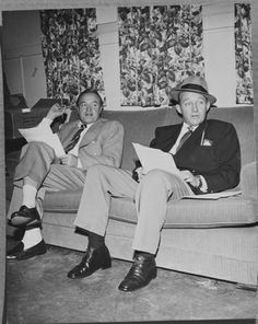 1950: EXCLUSIVE British-born actor and comedian Bob Hope (1903 - 2003) sits while rehearsing for his radio show with American actor and singer Bing Crosby