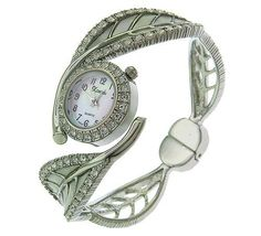 Leaf Shaped Ladies 18K Silver Plated Bangle Watch Made with SWAROVSKI Elements Xanadu. $34.95. Features scratch resistant mineral glass with mother-of-pearl dial and 3 hands movement. Japanese fine-tuned mechanics: precise quartz movement. The ultimate feminine ideal; stylishly contemporary with a touch of grace! GIFT BOX/POUCH INCLUDED!. One of a kind leaf design bangle 18K silver plated watch made with SWAROVSKI elements!. Exquisite case and band adorned with over 50...