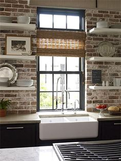 Modern style meets old-world charm. exposed brick kitchen backsplash with open shelving over apron sink and gray cabinets. -- open shelving brick behind Kitchen Inspirations, Brick Kitchen, Home, Exposed Brick Kitchen, Exposed Brick Kitchen Backsplash, Kitchen Remodel, White Brick Walls, Home Kitchens, Farmhouse Kitchen