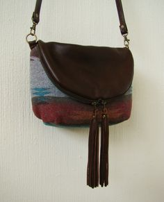Navajo Mini Fold Over Day Traveler, small brown leather and wool convertible cross body or shoulder bag. $215.00, via Etsy.