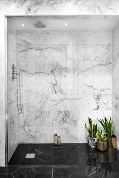 "As our co-founder Michele always says, ""If you don't love marble, you don't love life"". In this room, we replaced the bath with a walk-in shower room to give more space and a hotel-vibe. We used black marble flooring to create contrast and depth which rea Black Marble Bathroom, Marble Wall, Marble Floor, Marble Bathrooms, Gray Marble, Marble Tiles, Carrara Marble, Shower Cabin, Walk In Shower"