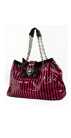 Too Fast's new bow bag will be sure to tickle your fancy. It features a shiny vinyl exterior with amazingly cool prints and designs, a working metal heart lock closure, a bow with grommits and silver chain straps.
