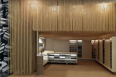 Aesop store by March Studio, Singapore store design...those are coconut husk strings suspended from the ceiling!