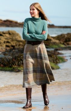 The perfect showcase for the disarming charm of our Sandstone and Sky plaid, this contemporary tweed swing skirt has a graceful, rippling movement.