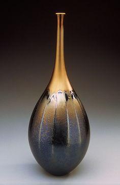Teardrop shaped vase with black & gold glaze by Hideaki Miyamura.  http://www.miyamurastudio.com.  Magnificent!!!