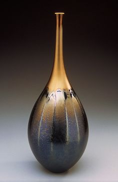 Teardrop shaped vase with black & gold glaze by Hideaki Miyamura. http://www.miyamurastudio.com. Magnificent!!!
