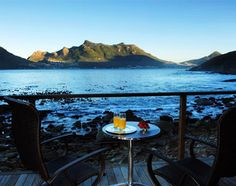 """""""In the base of a cliff top just outside of Cape Town overlooking the Atlantic in a cove — a relaxed base to explore the area. The wooden and glass property blends sympathetically into the surround… V&a Waterfront, Destin Hotels, Shark Diving, Cape Town South Africa, Table Mountain, Most Beautiful Cities, Local Artists, Nice View, Kayaking"""