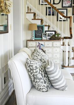 Neutral living room - love the gray pillows eclecticallyvintage.com