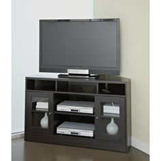 This contemporary corner TV stand is made of a durable wood construction and comes in a warm shade of espresso. This modern furniture piece will make a great addition to any room. Glass cupboards and multiple shelves add room for organization.