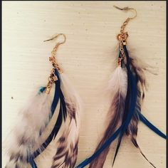Boho Feather Earrings These boho feather earrings are gorgeous! Pre loved but in excellent condition! These will add the perfect bohemian pop to any outfit. Jewelry Earrings