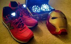 """A pair of New Balance 574 that is inspired by the """"Iron Man"""" Marvel character. The shoe takes inspiration from Tony Starks' suit of armor, sporting a red upper along with gold trim. The shoe also uses the arc reactor as inspiration, adding it to the tongue area."""