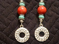 Colorful 2 1/2 in. dangle earrings w/ hammered silver plated disc, blue glass discs & red speckled glass focal bead. $15