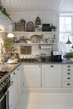 White cottage kitchen-would love these shelves for baking supplies in glass canisters!!