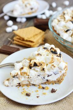 S'mores Ice Cream Pie Recipe on twopeasandtheirpod.com This S'mores pie is heavenly! A must make dessert for summertime!
