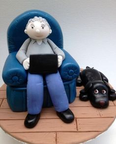 """I made this topper complete with Rice Krispie Armchair as a removeable option for a 10"""" madeira cake. It sits on an 8"""" board and weighs about 1.5kg. Dad Cake, 50th Cake, Cat Cake Topper, Fondant Toppers, Dad Birthday Cakes, 90th Birthday, Birthday Ideas, Fondant Man, Fondant People"""