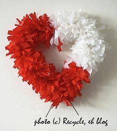 Valentine's Day wreath made by recycling some red and white (I ran out of red) plastic bags tied to a wire coat hanger.