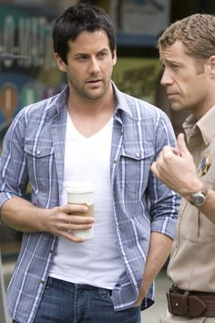 Niall Matter as Zane Donovan and Colin Ferguson as Jack Carter on Eureka from th...