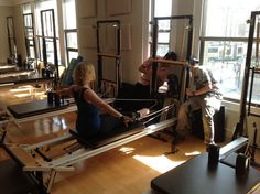 Doing Pilates while being filmed for my studio.
