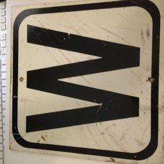 """A square metal """"W"""" sign by MiddleCoveAntiques on Etsy"""
