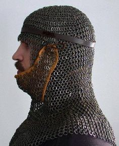 Proper reproduction of a 13th Century Mail Coif, made by Erik D. Schmid (pictured)