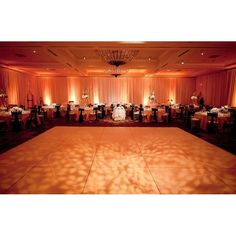 In love with the soft leaf patterned #gobo on the #dancefloor and the #peach #colorwash. Lovely photo via #36thStreetEvents