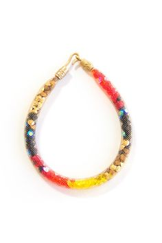 Your wrist just got a whole lot brighter.Peppercotton Coral Snake Bracelet, $185, available at Peppercotton.  From: 31 Bracelets We're Dying To Own Now