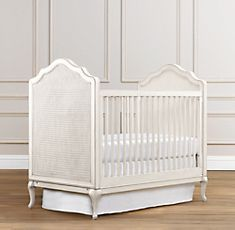 Love this cute little crib with its carved cabriole legs and woven cane panels.