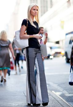 Want to instantly be tall and thin?  Let's see why this works. For starters, the stripe in the pant is a vertical line making the legs look longer and leaner. The pant is just under the waist line creating the long leg look. The shoes add lots of height and the oversize bag gives the body the appearance of being smaller. Tip: Take the shoes that you will wear shopping with you when you buy the pants to make sure that the length is perfect. Cheers to the new, taller and thinner you!