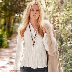 Delicate, cascading pintucks add a hint of retro charm to our chic crinkle blouse.
