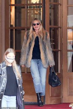 Living it up: Kate Moss jetted into curfew-hit Paris for her 47th birthday weekend where s...