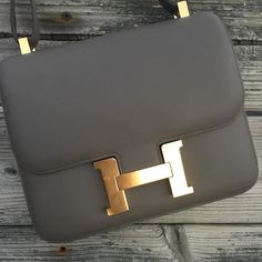Hermes 24cm Constance in etain swift leather with gold hardware