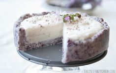 Coconut lime cream cake. Coconut butter and blueberry crust. Chia seeds. Edible flowers. Nut free. Raw. Vegan.