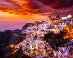 sunset in the beautiful city Oia, Santorini, Greece