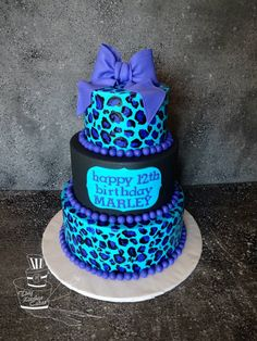 Black and Turquoise Cheetah print Birthday cake.