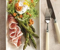 roasted asparagus and frisee salad with poached eggs and romesco sauce.
