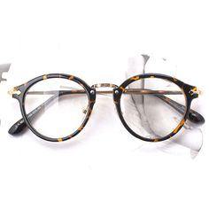 d8c1e0de899861 1920s Vintage Oliver Retro petites lunettes rondese 19R62 Tiger Skin Mode  Cadres