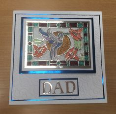 Love the stained glass dies by Sue Wilson. Made a Father's Day card using the humming bird die, Cosmic Shimmer Cosmic Twinkles, mirror card in blue and silver and the brambled Rose embossing folder