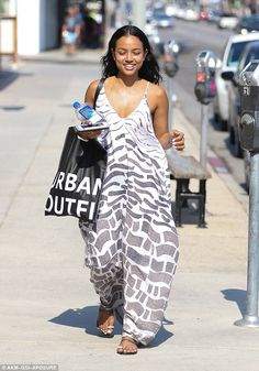 Beating the heat: Karrueche Tran donned a flowing sundress and sipped bottled water while hitting the shops in sweltering West Hollywood, CA on Tuesday