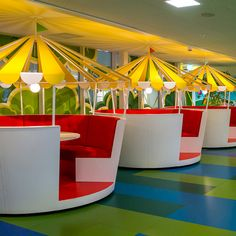 Carousel dining tables and trampoline seats are found around the funfair-inspired Stockholm offices for King, the company behind Candy Crush Saga.