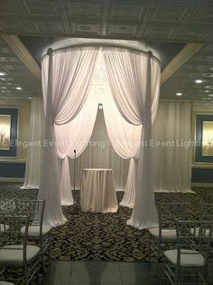 This circular Bridal Canopy's beautiful tiered drape swags create a romantic feel, perfect for the wedding ceremony.  Our Crystal Chandelier hung in the middle of the canopy provides a beautiful, soft glow and an instant touch of glamour.