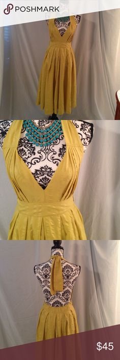 1950's Like Harvest Yellow Halter Dress Ties behind the neck. Size medium. Midi length, zips up the side. Has belt loops but there is no belt included it was worn without one. Elastic lower back. Dresses Midi