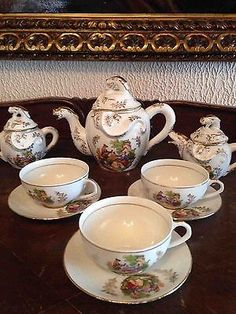Antique japan porcelain coffee   set  with 3 cups/saucers