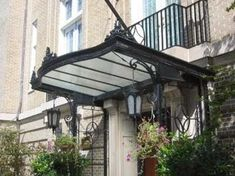 Installing a canopy on the home page at the moment is no longer a strange thing. Many houses, both classic, . Minimalist Home, Minimalist Design, Canopy Design, Protecting Your Home, Classic House, Modern House Design, Architecture Design, Outdoor Structures, In This Moment